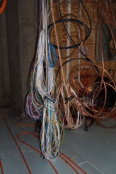 These are the wires for the low-voltage system.  Seriously:  I freak out when asked to look at the wires behind one TV when I am having cable issues.  This would drive me over the edge!