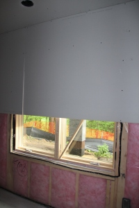 Something we didn't know:  they install drywall first, then cut around the windows.  This is Carter's bedroom window.