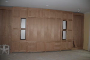 The basement cabinets.  The white rectangles are where speakers and speaker cloth will be.  The empty spaces on either end will be bookshelves.