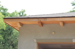 The pickups (wood brackets) above the garage.  The little square is part of one of the original bricks.