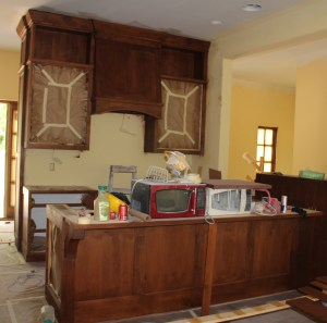 The kitchen island in foreground, with range area in background.  The window to the right is in the stairwell.