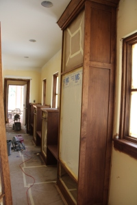 A shot of the front hall cabinetry, looking towards the garage.