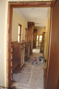 The front hall looking from the laundry room towards the entry and stairwell.
