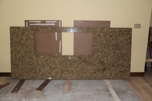 The kitchen island counter top, with cut out for sink