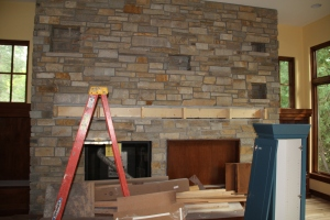 I love the fireplace!  It still needs the sealant on the stone, which will intensify the colors