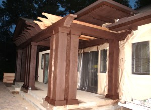 Pergola in process of being painted