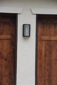 An outdoor light between the garage doors