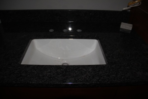Poorly lit image of a sink in the master bath