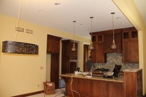 Another view of kitchen, with dining room chandelier on left (that's Super Bill lurking in the back)