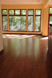 The great room floors a-gleaming!  That weird squiggle on the floor in the middle is a wire for an electrical outlet.