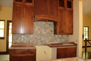 The stone backsplash is up in the kitchen!