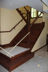 The stairs are now stained.  Next week the carpet runner goes on and the metal spindles are installed