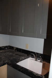 Dusty laundry room counter and sink