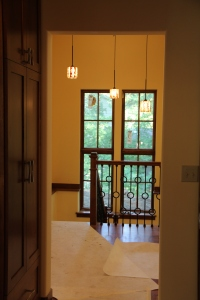 A view from the front hall to the stairwell with new railings and light fixture in place!
