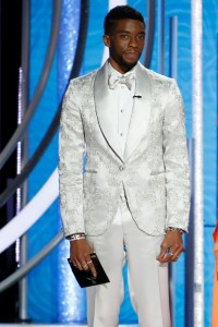 Chadwick Bosnan: is this the costar MPJ is expecting to come doen the aisle? Cuz he looks like a prom kid who made his tux out of mama's wedding gown