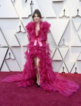Linda Cardellini (worst look of the night?) I mean: every trend wrapped up -- literally -- with a bow)