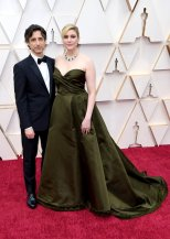 Noah Baumbach and Great Gerwig: love her dress, but don't like the meralds with it